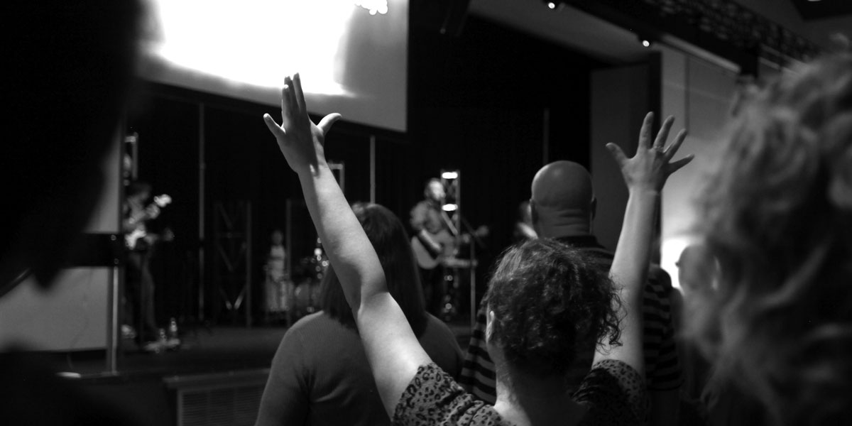 Worshipping with hands up at Cornwall Skagit